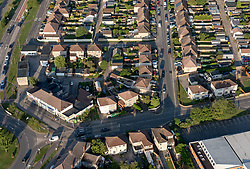 © Licensed to London News Pictures. 29/07/2019; Bristol, UK. View over housing in Patchway. Press preview event for the 41st Bristol International Balloon Fiesta 2019 which will take place from 08 - 11 August 2019. For the preview up to 25 hot air balloons will take off from Filton Airfield (soon to be developed for housing), next to the Brabazon Hangar which is the site of a proposed new YTL Arena, and Aerospace Bristol to play homage to the 50th anniversary of Concorde. The Bristol International Balloon Fiesta attracts hundreds of thousands of visitors and this year the Fiesta will be celebrating Icons of Bristol and look to highlight some of the things that make up the home of the International Balloon Fiesta. The event has joined forces with Aerospace Bristol to honour one of the city's most famed creations, Concorde and Aardman Animations who are celebrating the 30th anniversary of Wallace and Gromit. Over the course of four days, the Bristol International Balloon Fiesta will play host to more than 100 colourful hot air balloons of all sizes and shapes. Special shapes are an iconic part of the Fiesta and the event kicks off with its now traditional special shapes launch on Thursday evening of 08 August. Photo credit: Simon Chapman/LNP.