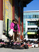 Woman entering Hall of the Great Hero, leaving shoes outside the Daeung-jeon at Jogye-sa Buddhist Temple, Seoul, South Korea. Jogyesa is the main temple of the Jogye Order of Korean Buddhism, and has a important part in Seon Buddhism. Located in Gyeonji-dong, Jongno-gu within in the old city of Seoul.