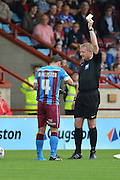 Sean McAllister  yellow card during the Sky Bet League 1 match between Scunthorpe United and Crewe Alexandra at Glanford Park, Scunthorpe, England on 15 August 2015. Photo by Ian Lyall.