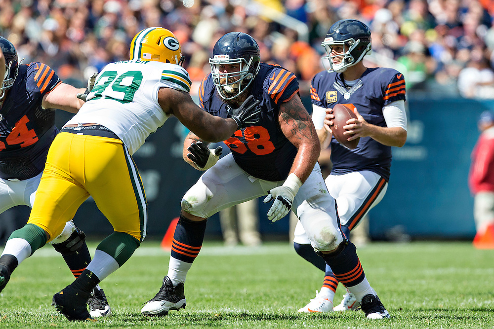 CHICAGO, IL - SEPTEMBER 13:  Matt Slauson #68 of the Chicago Bears blocks Bruce Gaston #99 of the Green Bay Packers at Soldier Field on September 13, 2015 in Chicago, Illinois.  The Packers defeated the Bears 31-23.  (Photo by Wesley Hitt/Getty Images) *** Local Caption *** Matt Slauson; Bruce Gaston