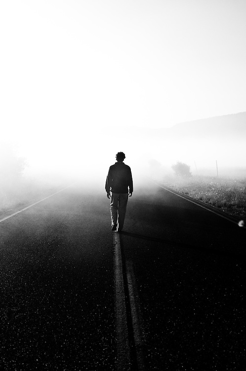 A self portrait walking down Stampfli Road into early morning fog in Indian Valley, California.