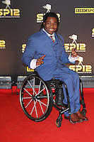 LONDON - DECEMBER 16: Ade Adepitan attended the BBC Sports Personality of the Year at ExCeL, London, UK. December 16, 2012. (Photo by Richard Goldschmidt)
