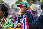 "09 MAY 2014 - BANGKOK, THAILAND:  Thai anti-government protestors listen to Suthep Thaugsuban speak in Lumpini Park Friday. Thousands of Thai anti-government protestors took to the streets of Bangkok Friday to start their ""final push"" to bring the popularly elected of government of Yingluck Shinawatra. Yingluck has already been forced out by a recent court ruling that forced her to resign and she is facing indictment by the National Anti Corruption Commission of Thailand for alleged improprieties related to a government rice price support scheme. The protestors Friday were marching to demand that she not be allowed to return to politics. The courts have not banned her party, Pheu Thai, which has formed an interim caretaker government to govern until elections expected in July, 2014. Suthep Thaugsuban, secretary-general of the People's Democratic Reform Committee (PDRC),  said the president of the Supreme Court and the new senate speaker, who would be selected Friday, should set up an ""interim people's government and legislative assembly."" He went onto say that if they didn't, he would.    PHOTO BY JACK KURTZ"