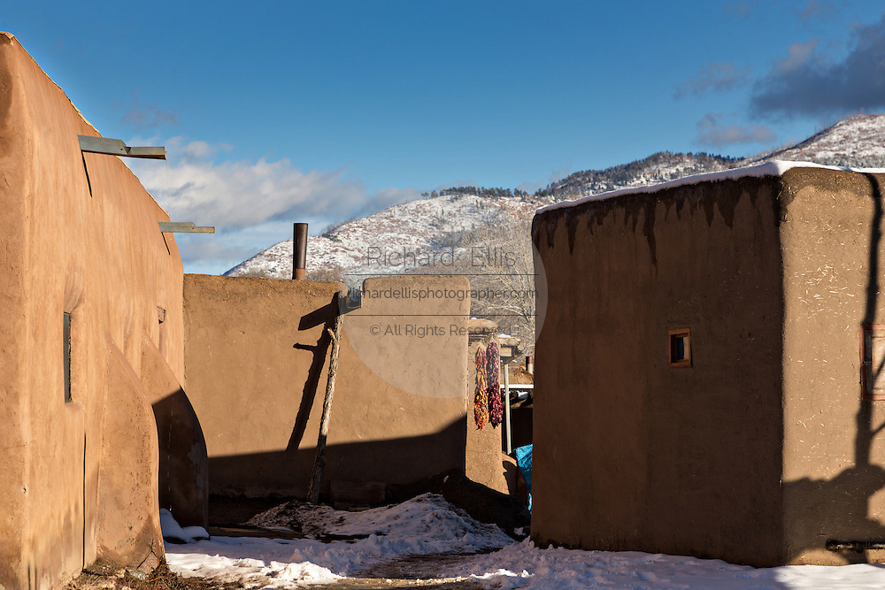 Adobe buildings with the Sangre de Cristo mountains at the ancient Native American Taos Pueblo outside Taos, New Mexico. The pueblos are considered to be one of the oldest continuously inhabited communities in the United States and is designated a UNESCO World Heritage Site.