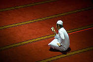 A man reads the Koran at Asia's biggest Islamic temple, Masjid Istiqlal.