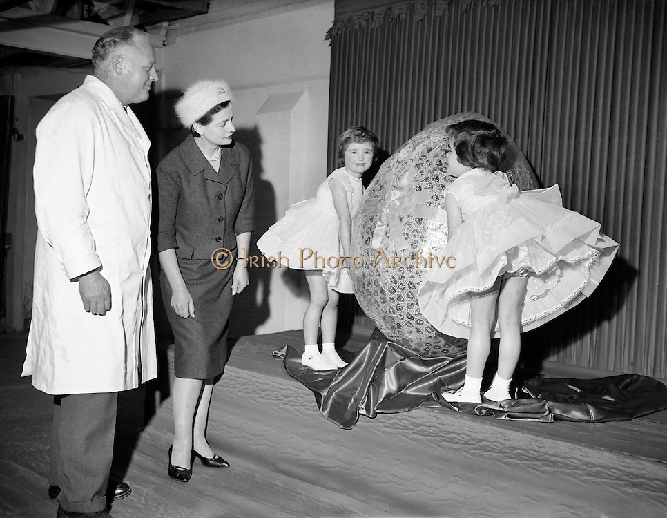 Chocolate manufacturers Urney present a giant Easter Egg to the ISPCC..23.02.1961 Mr T Headon former Irish International Rugby player 1938/9 and his 2 daughters Mary and Barbara (Bobby) Thomas Headon was Lady Killanin