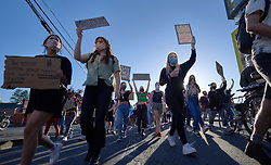 Protesters march during a June 3, 2020, Black Lives Matter protest in Eugene, Oregon. Participants were protesting the murder of George Floyd and other African-Americans by police.
