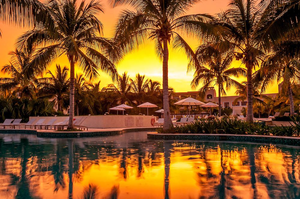 Hacienda Tres Rios Resort swimming pool at sunset; Riviera Maya, Mexico.