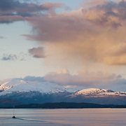 Three weeks aboard the Kong Harald. Hurtigruten, the Coastal Express. The landscape of a midnight sun near Molde.