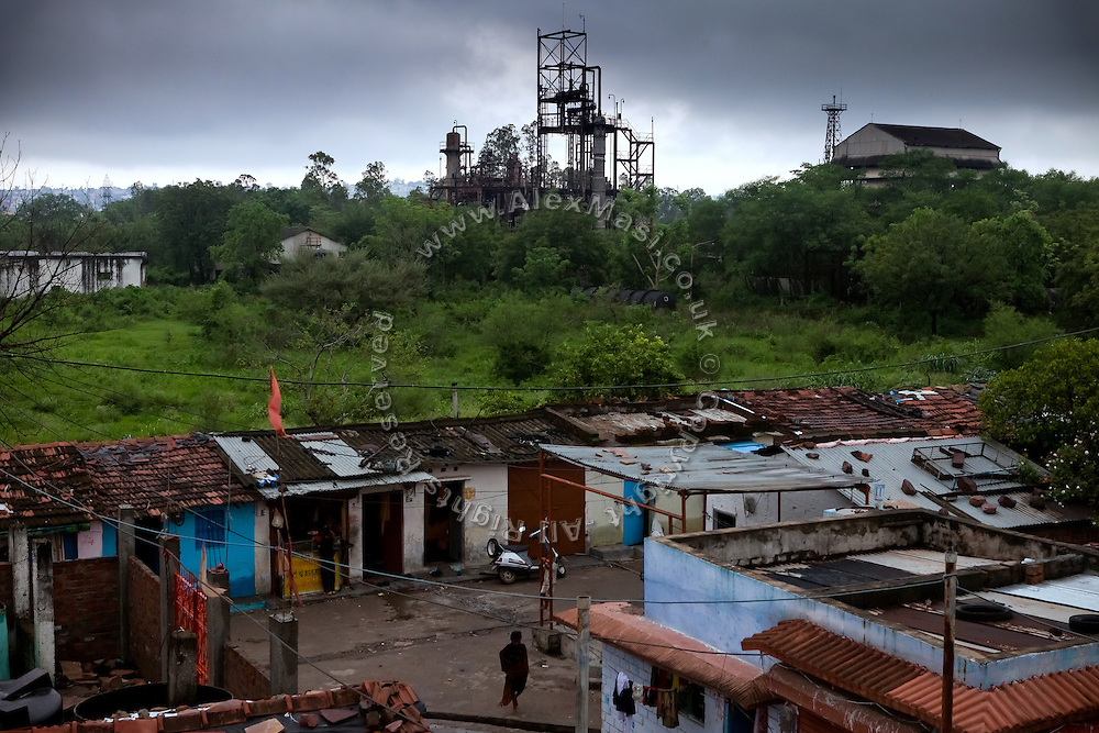 A boy is passing through Arif Nagar, one of the water-affected colonies surrounding the abandoned Union Carbide (now DOW Chemical) industrial complex in Bhopal, Madhya Pradesh, India, site of the infamous 1984 gas tragedy. The poisonous cloud that enveloped Bhopal left everlasting consequences that today continue to consume people's lives.