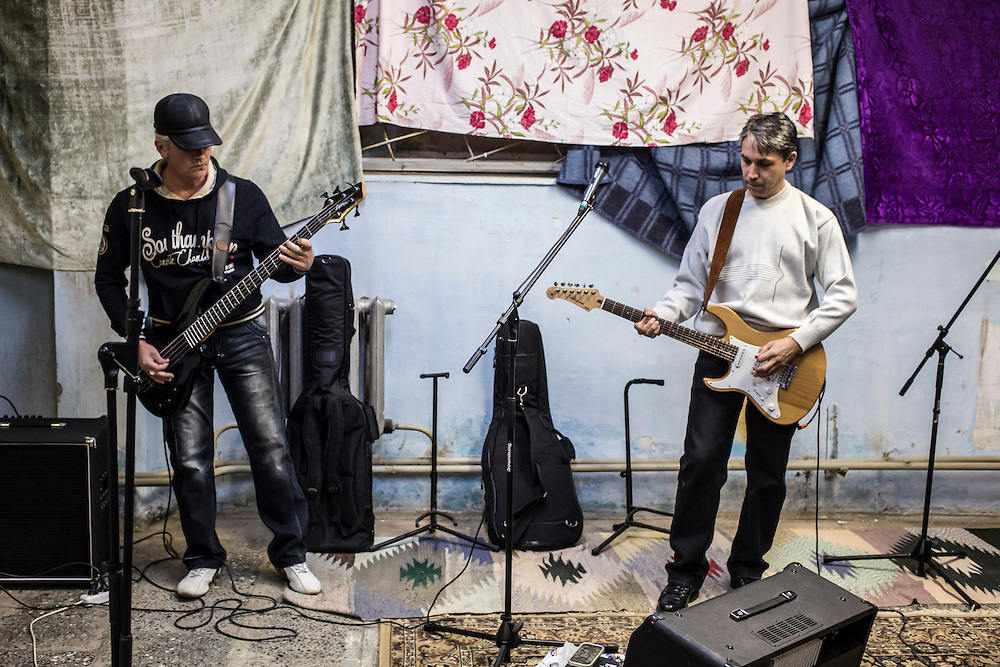 Salavat Gabrullin and Valery Shekin of the band Hammer and Sickle rehearse in the basement of a local school on Tuesday, November 12, 2013 in Asbest, Russia.