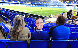 """A young Everton fan with a face mask of goalkeeper Jordan in the stands during the Premier League match at Goodison Park, Liverpool. PRESS ASSOCIATION Photo. Picture date: Saturday August 18, 2018. See PA story SOCCER Everton. Photo credit should read: Peter Byrne/PA Wire. RESTRICTIONS: EDITORIAL USE ONLY No use with unauthorised audio, video, data, fixture lists, club/league logos or """"live"""" services. Online in-match use limited to 120 images, no video emulation. No use in betting, games or single club/league/player publications."""
