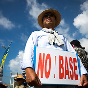 OKINAWA, JAPAN - JUNE 17 : A man protester holding a placard 'NO! BASE' demanding the withdrawal of US bases from Okinawa, takes part in a rally in front of the US base in Camp Schwab, on June 17, 2016 in Nago, Okinawa, Japan. Protests have grown more intense in the past days due to the past incident of rape of a Japanese woman and drunk driving in Okinawa over American military presence in Japan. Photo: Richard A. de Guzman