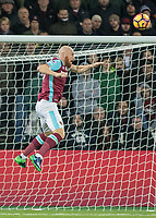 Football - 2016 / 2017 Premier League - West Ham United vs. Stoke City<br /> <br /> James Collins of West Ham rises to head the ball at The London Stadium.<br /> <br /> COLORSPORT/DANIEL BEARHAM