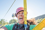 Woman screaming while zip lining in the Snake River Canyon with Zip the Snake in Twin Falls, Idaho. MR
