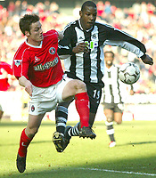 Photo: Scott Heavey<br />Charlton V Newcastle. 15/03/03.<br />Scott Parker (left) battles with Tius Bramble during this Premiership match.