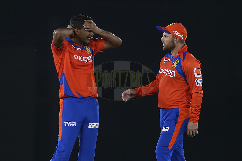 Praveen Kumar of Gujarat Lions whinges in pain and holds his head and neck after bowling a delivery as Brendon McCullum of Gujarat Lions checks up on him during match 3 of the Vivo Indian Premier League (IPL) 2016 between the Kings XI Punjab and the Gujarat Lions held at the IS Bindra Stadium, Mohali, India on the 11th April 2016<br /> <br /> Photo by Shaun Roy/ IPL/ SPORTZPICS