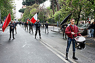 Roma 19 Aprile 2014.<br /> Gli Antifascisti in corteo,al quartiere San Lorenzo, portano un omaggio floreale al monumento dei caduti nella lotta per la liberazione al nazifascismo al cimitero del Verano .<br /> Rome, Italy. 19st April 2014 -- Antifascist Parade for anniversary of liberation from Nazi-fascism. -- Anti-Fascists in the parade carrying a wreath at the monument of the fallen in the struggle for the liberation of Nazi-fascism in the Verano cemetery.