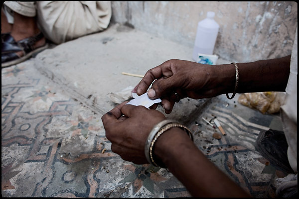 """One dose of heroin cost just few rupees, the equivalent of 0.3 USD. Rawalpindi, Pakistan, on thursday, August 14 2008.....""""Pakistan is one of the countries hardest hits by the narcotics abuse into the world, during the last years it is facing a dramatic crisis as it regards the heroin consumption. The Unodc (United Nations Office on Drugs and Crime) has reported a conspicuous decline in heroin production in Southeast Asia, while damage to a big expansion in Southwest Asia. Pakistan falls under the Golden Crescent, which is one of the two major illicit opium producing centres in Asia, situated in the mountain area at the borderline between Iran, Afghanistan and Pakistan itself. .During the last 20 years drug trafficking is flourishing in the Country. It is the key transit point for Afghan drugs, including heroin, opium, morphine, and hashish, bound for Western countries, the Arab states of the Persian Gulf and Africa..Hashish and heroin seem to be the preferred drugs prevalence among males in the age bracket of 15-45 years, women comprise only 3%. More then 5% of whole country's population (constituted by around 170 milion individuals),  are regular heroin users, this abuse is conspicuous as more of an urban phenomenon. The substance is usually smoked or the smoke is inhaled, while small number of injection cases have begun to emerge in some few areas..Statistics say, drug addicts have six years of education. Heroin has been identified as the drug predominantly responsible for creating unrest in the society."""""""