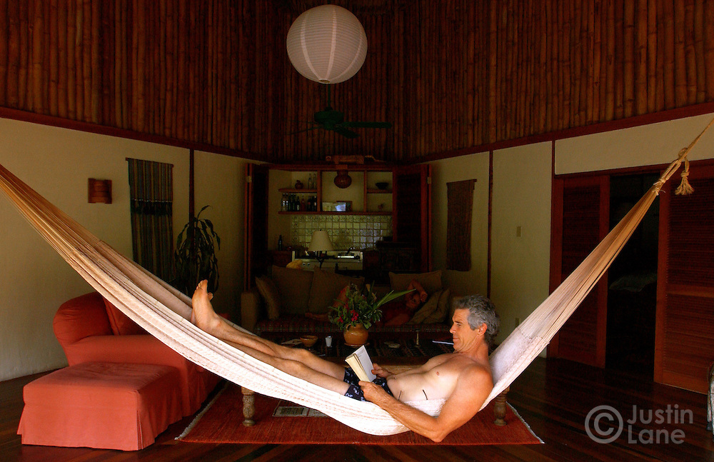 Chris Thompson relaxes in a hammock in one of the villas at the Blancaneaux Lodge, one of Francis Ford Coppola's resorts, in the eastern part of Belize.<br />