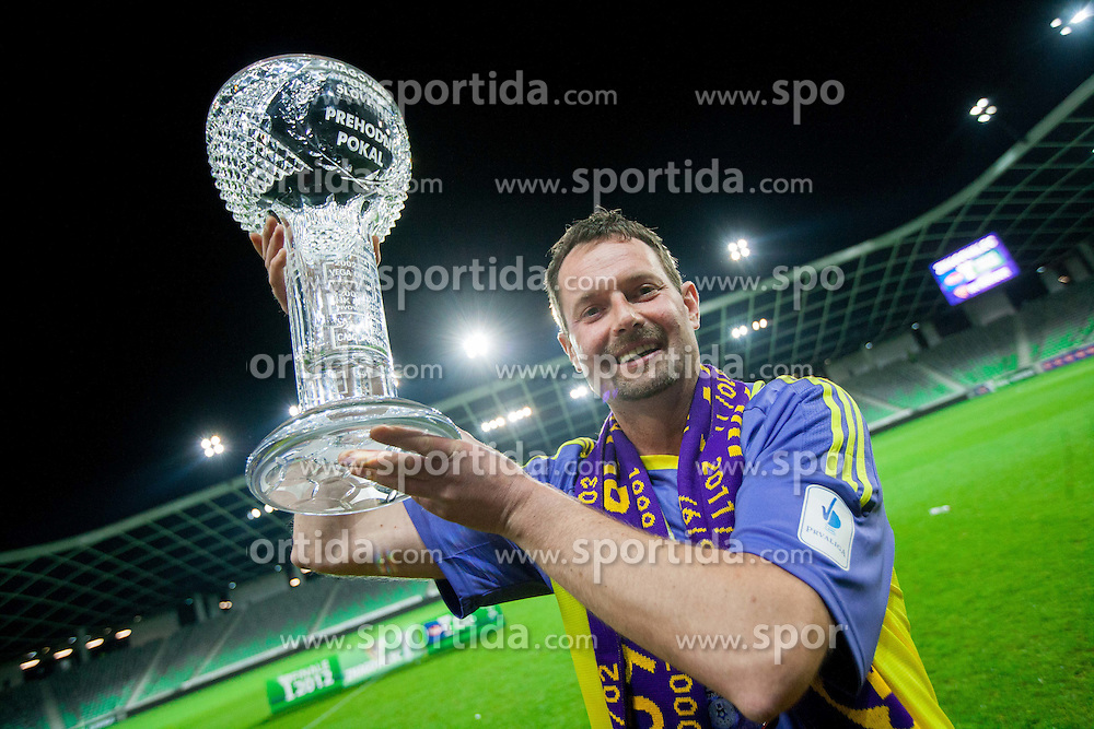 Fan Matjaz Muster celebrates with a trophy after the football match between NK Celje and NK Maribor in final of Hervis Cup 2011/12, on May 23, 2012 in SRC Stozice, Ljubljana, Slovenia. Maribor defeated Celje after penalty shots and became Slovenian Cup Champion. (Photo by Vid Ponikvar / Sportida.com)