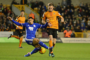 Birmingham City striker Che Adams (14) makes a tackle on Wolverhampton Wanderers defender Richard Stearman (5) 0-2 during the EFL Sky Bet Championship match between Wolverhampton Wanderers and Birmingham City at Molineux, Wolverhampton, England on 24 February 2017. Photo by Alan Franklin.
