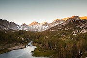 The sun rises on the Sierra Nevada and Bear Creek Spire at the head of the Little Lakes Valley.