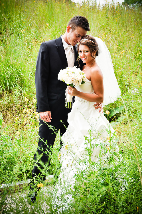 Michelle & Alan pose in the prairie grass outside Holy Spirit Catholic Community Church, Naperville, IL, IL