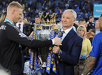 Football - 2015 / 2016 Premier League - Leicester City vs. Everton<br /> <br /> Leicester Manager Claudio Ranieri is handed the trophy from Kasper Schmeichel at the King Power Stadium.<br /> <br /> COLORSPORT/ANDREW COWIE
