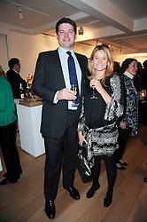 ROBIN WOODS and KATE SHAND at a private view of recent paintings, drawings and prints by Dione Verulam (Countess of Verulam) held at Sladmore Contemporary art gallery, 32 Bruton Place, London on 10th February 2010.