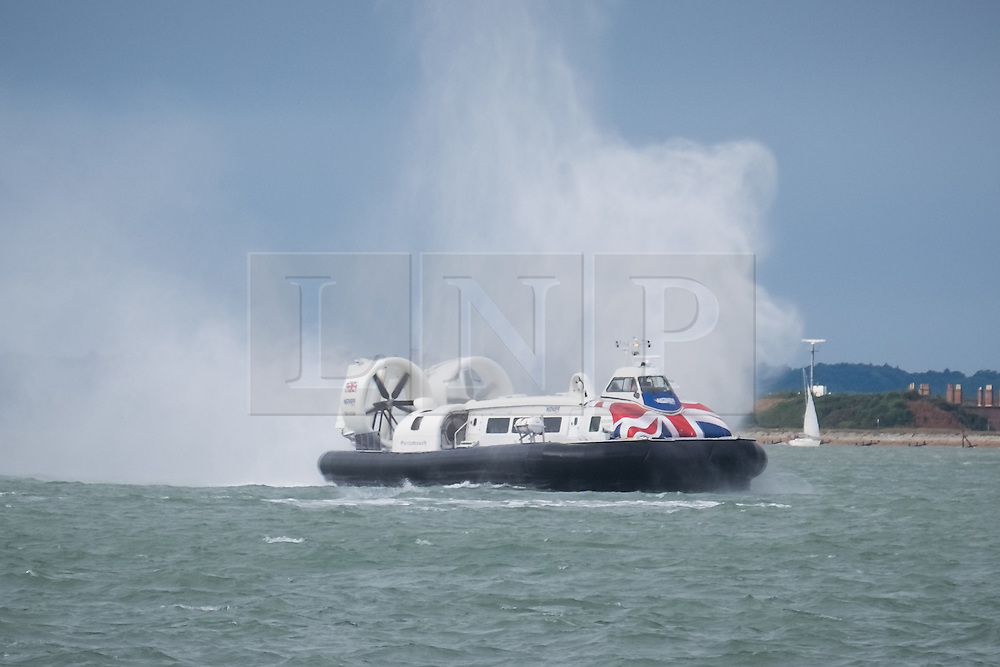 © Licensed to London News Pictures. 29/09/2016. Portsmouth, Hampshire, UK.  The Isle of Wight Hovercraft struggles more than usual to cross the Solent during the strong winds this morning, 29th September 2016. Wet and windy weather hits the south coast this morning following days of warm sunny weather. Photo credit: Rob Arnold/LNP