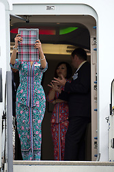 © London News Pictures. 09/07/2012. Farnborough, UK. A Malaysian Airlines Stewardess using her iPad to take a picture of the surroundings from an Airbus A380 on day one of the Farnborough International Airshow, in Farnborough, Hampshire, UK on July 9, 2012. FIA is a seven-day international trade fair for the aerospace industry which is held every two years at Farnborough Airport . Photo credit: Ben Cawthra/LNP.