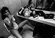 Stripper having a cigarette break, Western Australia, 2000's