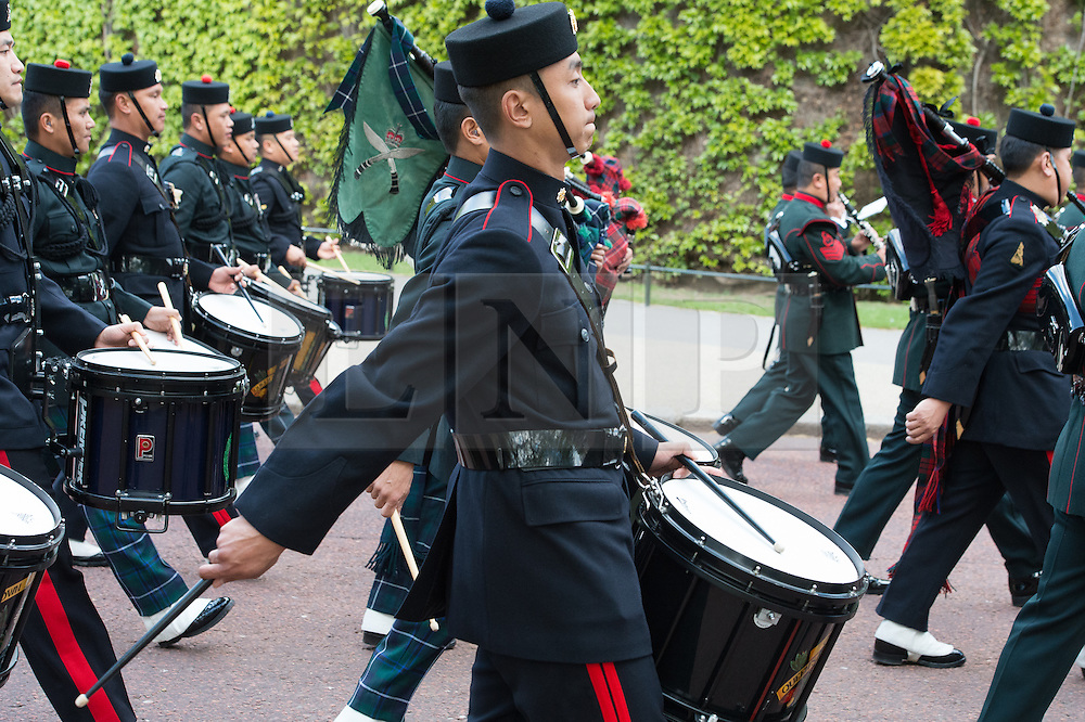 © London News Pictures. 03/04/15. London, UK. Gurkha Regiments march down the Mall as part of the 200 year celebrations of the formation of the British Gurkhas, Central London. Photo credit: Laura Lean/LNP