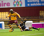 23rd December 2017, Fir Park, Motherwell, Dundee; Scottish Premier League football, Motherwell versus Dundee; Motherwell's Cedric Kipre on the ball as Dundee's Faissal El Bakhtaoui claims for a foul