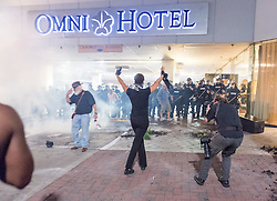 September 21, 2016 - Charlotte, North Carolina, U.S. - Protestors confront police at the Omni Hotel during a protest and eventual riot in uptown. This is the second day of violence that erupted after a police officer's fatal shooting of an African-American man Tuesday afternoon. (Credit Image: © Sean Meyers via ZUMA Wire)