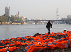 EDITORIAL USE ONLY Hundreds of lifejackets lie on the bank of the River Thames in London to highlight the plight of refugees who have fled war-torn countries in search of safety in Europe, in a visual installation by ActionAid and Islamic Relief ahead of the Refugees Welcome Here march on Saturday.