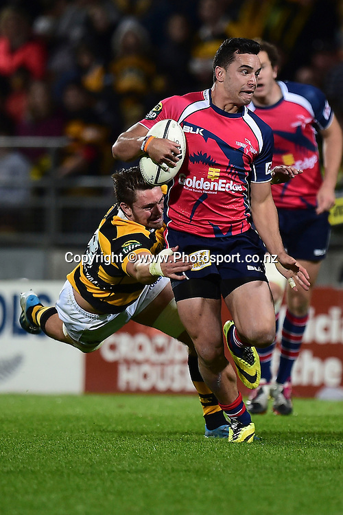 Tasman Makos James Lowe is tackled by Taranaki's Mitchell Brown during the ITM Cup Premiership Final between Taranaki & Tasman at Yarrow Stadium in New Plymouth, New Zealand, 25th October 2014. Photo: Marty Melville/Photosport.co.nz