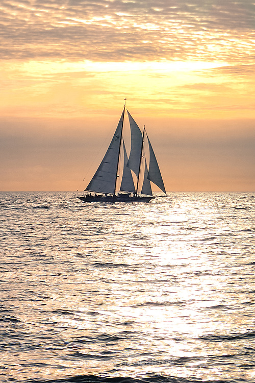 Schooner Martha caries full sail into a beautiful sunset, Strait of Juan de Fuca.  2014 Swiftsure International Yacht Race, Victoria, British Columbia, Canada.  Olympus Tough TG-1.