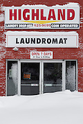 Highland Laundromat, which is normally open 7 days a week, was closed after Winter Storm Nemo dropped about 2 feet of snow overnight on Somerville, Massachusetts, U.S., on Saturday, Feb. 9, 2013. Photographer: Kelvin Ma/Bloomberg