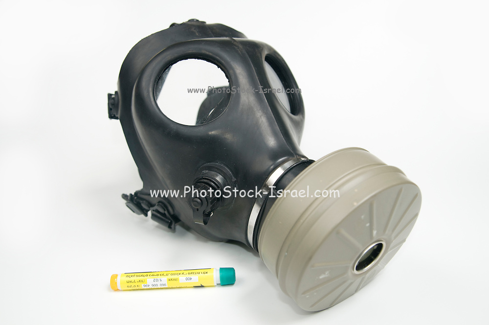Cutout of a Gas Mask and Atropine injection on white background elevated side view