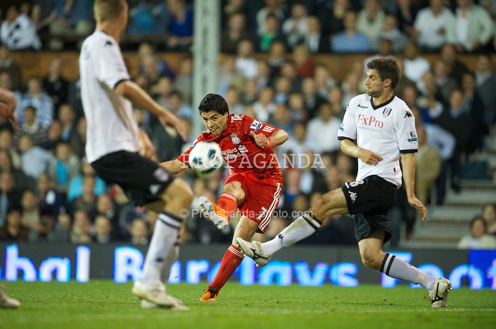LONDON, ENGLAND - Monday, May 9, 2011: Liverpool's Luis Alberto Suarez Diaz fires in on the Fulham goal during the Premiership match at Craven Cottage. (Photo by David Rawcliffe/Propaganda)