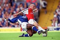 Fredrik Ljungberg (Arsenal) Titus Bramble (Ipswich Town). F.A.Carling Premiership,23/9/2000. Credit: Colorsport / Stuart MacFarlane.