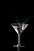 Splash in mrtini glass on black background