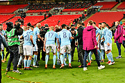 The Manchester City players dance around the Carabao Cup during the celebrations at full time after the 3-0 win over Arsenal during the EFL Cup Final match between Arsenal and Manchester City at Wembley Stadium, London, England on 25 February 2018. Picture by Graham Hunt.