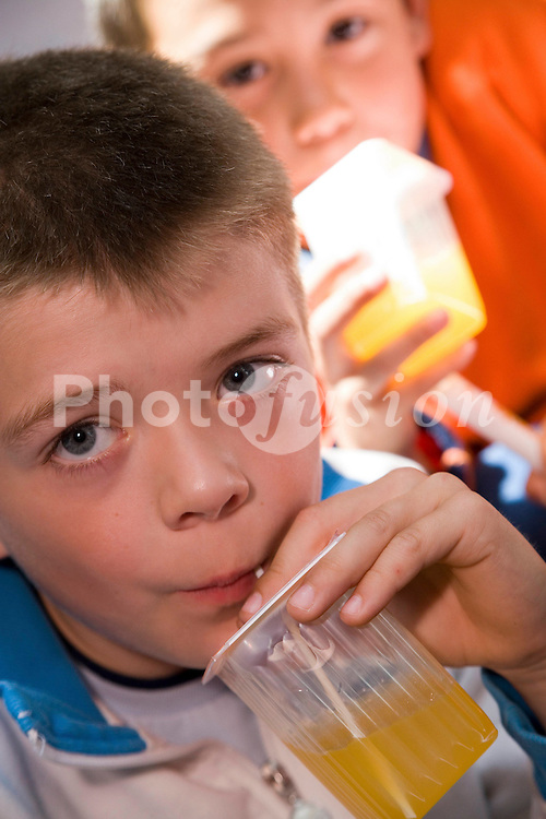 Children drinking from juice cartons,