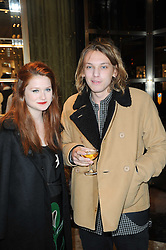 BONNIE WRIGHT and JAMIE CAMPBELL BOWER at a Cocktail party to celebrate the opening of the new Miu Miu boutique, 150 New Bond Street, London hosted by Miuccia Prada and Patrizio Bertelli on 3rd December 2010.
