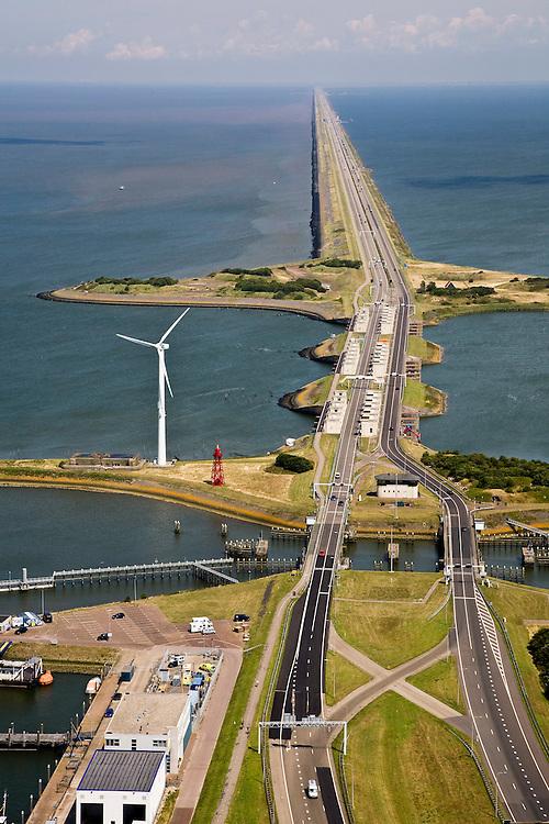 Nederland, Noord-Holland, Den Oever, 14-07-2008; Afsluitdijk, waterkering tussen Waddenzee en IJsselmeer (rechts, voorheen Zuiderzee). Aanleg van de dijk vormde onderdeel Zuiderzeewerken, initiatief van ingenieur Cornelis Lely. In de dijk de Stevinsluizen, spuisluizen of uitwaterende sluizen. Het 'eiland' heet Robbenplaat.<br /> The IJsselmeer Dam or Enclosure Dam, dike between the provinces Noord-Holland and Friesland, left Wadden sea, right former Zuyder Zee (now inner sea/lake). In the foreground locks for shipping and sluicing surplus water. luchtfoto (toeslag), aerial photo (additional fee required)<br /> foto/photo Siebe Swart