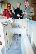 Royal Academicians Anne Desmet, Rebecca Slater and Richard Wilson examine the model. Achitect, Sir David Chipperfield unveils plans for a major redevelopment of the Royal Academy of Arts which will be completed in time for its 250th anniversary in 2018. The project is the most important development of the Royal Academy in its history.  The development will allow key works from the Royal Academy's Collection to be brought out of store and go on view to the public. These include Queen Victoria's paintbox, Turner's travelling watercolour box, Joshua Reynolds' diaries, a rarely displayed Pissarro drawing, and letters between artists such as Thomas Gainsborough to Sir Joshua Reynolds. 11 May 2015.