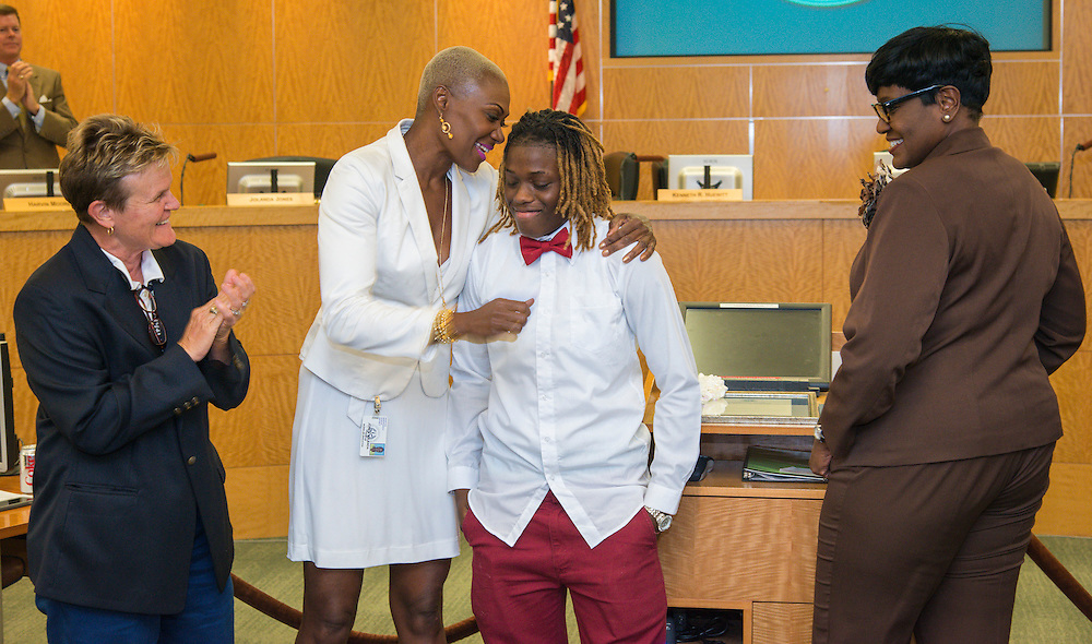 Marmion Dambrino and Trustee Jolanda Jones and Trustee Wanda Adams congratulate Brandolyn Walker during a meeting of the Board of Trustees, June 9, 2016.